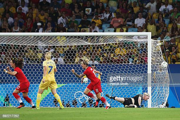 Dzsenifer Marozsan of Germany scores past goalkeeper Hedvig Lindahl of Sweden during the Women's Olympic Gold Medal match between Sweden and Germany...