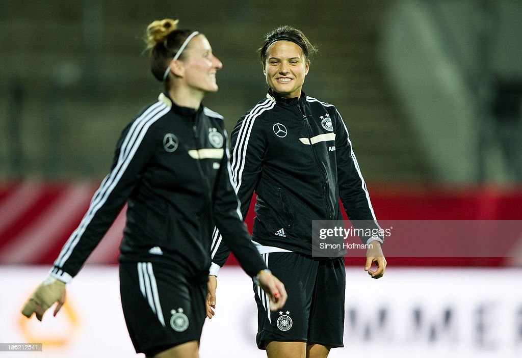 Dzsenifer Marozsan of Germany smiles during a Germany training session at Volksbank Stadion on October 29, 2013 in Frankfurt am Main, Germany.