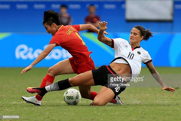 Dzsenifer Marozsan of Germany tackles Chen Gao of China during the Women's Football Quarterfinal match between China and Germany on Day 7 of the Rio...
