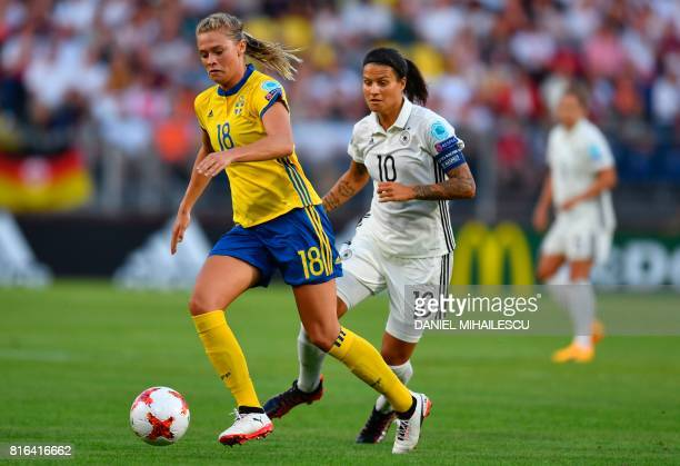 Dzsenifer Marozsan of Germany vies with Fridolina Rolfo of Sweden during the UEFA Womens Euro 2017 football tournament between Germany and Sweden at...