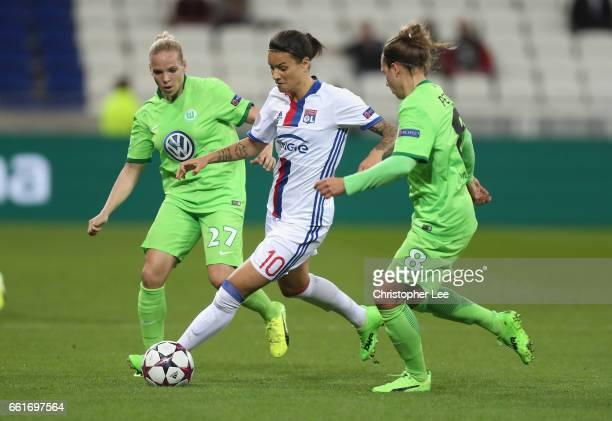 Dzsenifer Marozsan of Olympique Lyon battles with Isabel Kerschowski of VFL Wolfsberg and Babett Peter of VFL Wolfsberg during the Women's Champions...
