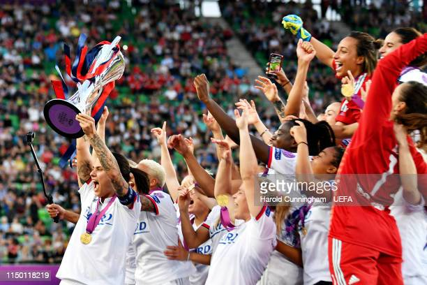 Dzsenifer Marozsan of Olympique Lyonnais Women lifts the trophy with her team after winning the UEFA Women's Champions League Final between Olympique...