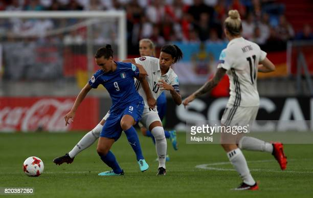 Dzsenifer Marozsán of Germany and Ilaria Mauro of Italy compete for the ball during the Group B match between Germany and Italy during the UEFA...