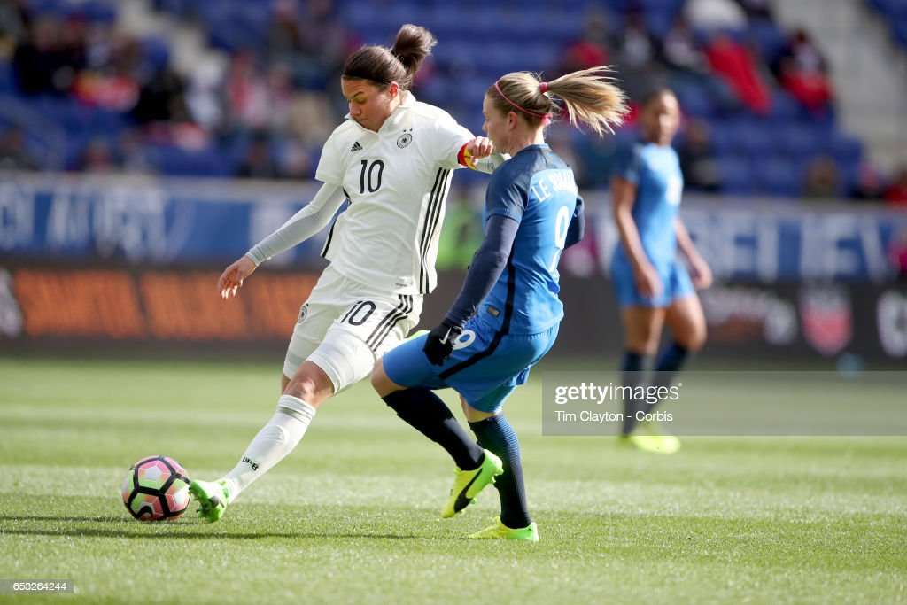 Dzsenifer Marozsán #10 of Germany challenged by Eugénie Le Sommer #9 of France during the France Vs Germany SheBelieves Cup International match at Red Bull Arena on March 4, 2017 in Harrison, New Jersey.