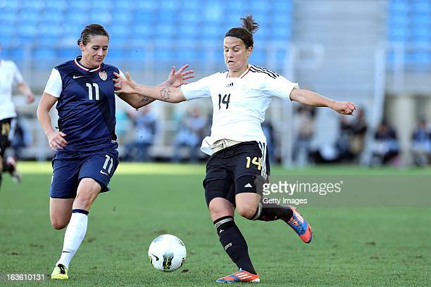 Dzsenifer Marozzsan of Germany challenges Ali Krieger of USA during the Algarve Cup 2013 Final at the Estadio Algarve on March 13 2013 in Faro...