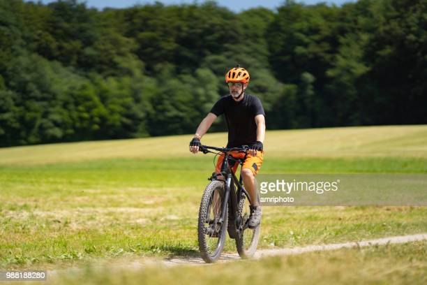 e mountainbiker on trail on sunny day