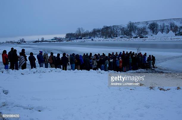 Each dawn at the Oceti Sakowin camp Just outside of the Lakota Sioux reservation of Standing Rock North Dakota begins with a women's prayer ritual...