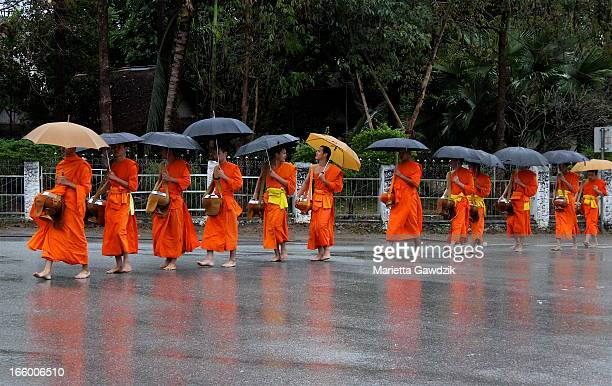 Each morning, hundreds of Buddhist monks line up in their deep orange robes and walk along the road to receive alms from the people of Luang Prabang,...