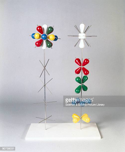 Each of these models consists of a steel rod with support wires and eighteen wooden lobes in five colours Atomic orbitals are the region surrounding...