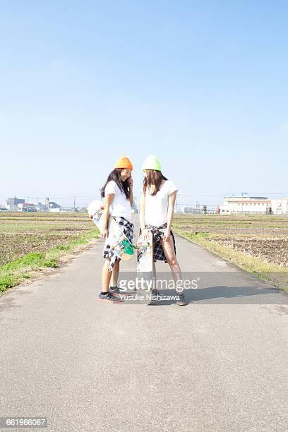 each other staring girl skater - yusuke nishizawa bildbanksfoton och bilder