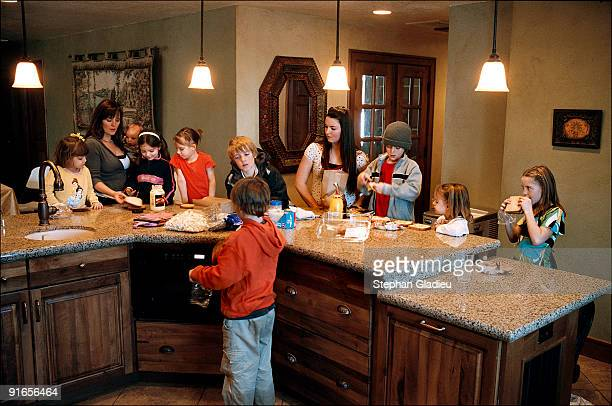 Each school-age kid in this polygamist family consisting of one father, three mothers and 21 children, has to prepare his own lunch box . Vicki, one...