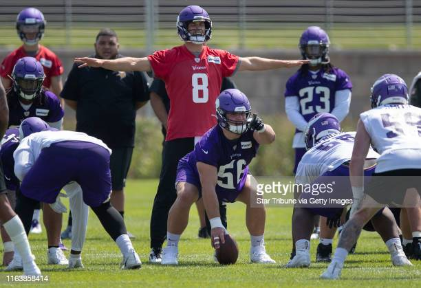 Rookie center Garrett Bradbury prepared to snap the ball to quarterback Kirk Cousins during the first day of training for Vikings rookies at TCO...