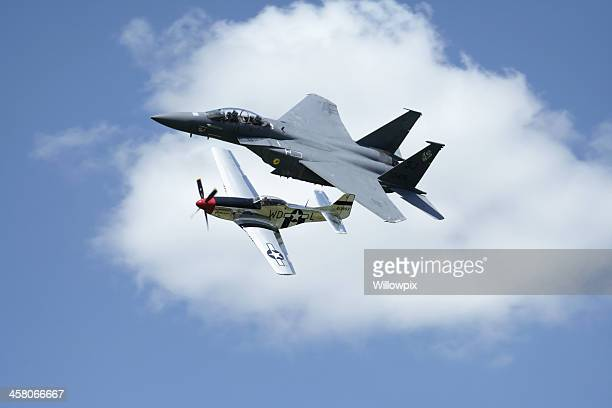 f-15 eagle fighter jet and vintage p-51 mustang at airshow - p 51 mustang stock photos and pictures