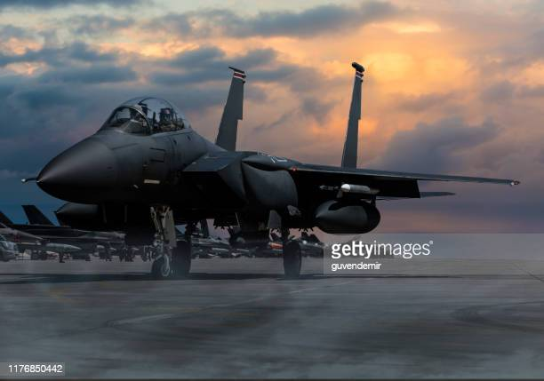 f-15 eagle fighter plane at sunset - base stock pictures, royalty-free photos & images