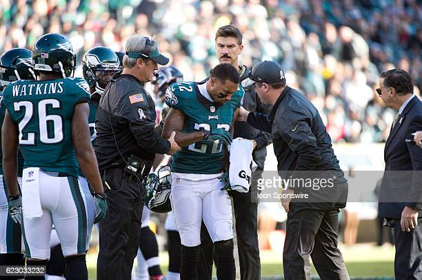 Eagle Head Coach Doug Pederson helps Philadelphia Eagles Cornerback Nolan Carroll up after a head injury in the first half during the game between...