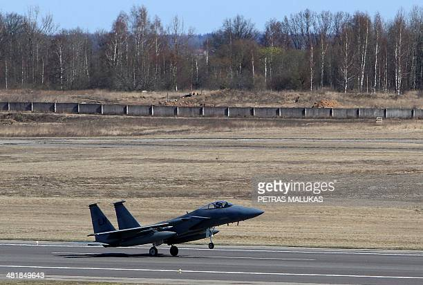 Eagle jet fighter lands at air force base during the Lithuanian NATO air force exercise at the air force base near Siauliai Zuokniai Lithunaia on...