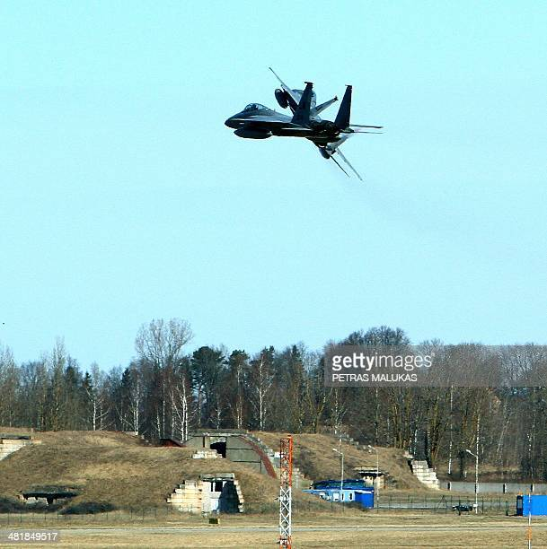 Eagle jet fighters fly over air force base during the Lithuanian NATO air force exercise at the air force base near Siauliai Zuokniai Lithunaia on...