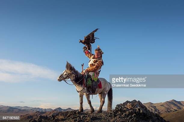 eagle-hunter on the horse in mongolia - independent mongolia stock pictures, royalty-free photos & images