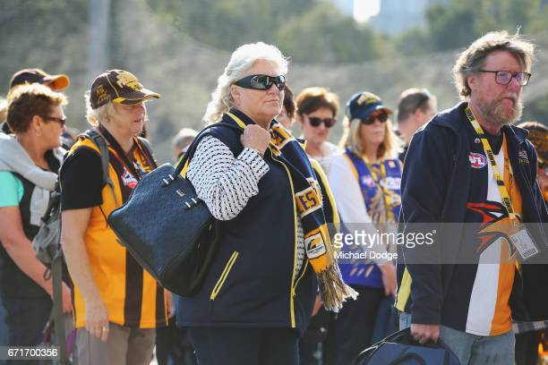 Eagles and Hawks fans arrive during the round five AFL match between the Hawthorn Hawks and the West Coast Eagles at Melbourne Cricket Ground on...