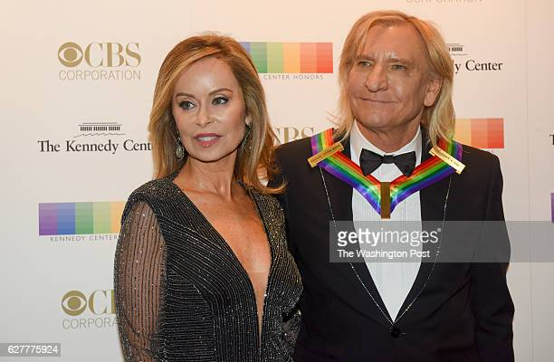 Eagles band member Joe Walsh R a 2016 Kennedy Center Honoree and his wife Marjorie Bach walk the red carpet at the 2016 Kennedy Center Honors at the...