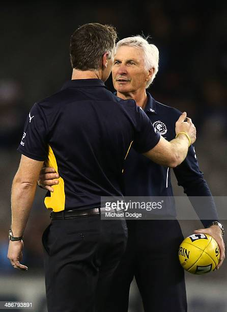 Eagles coach Adam Simpson and Blues coach Michael Malthouse embrace during the round six AFL match between the Carlton Blues and the West Coast...