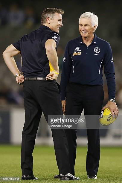 Eagles coach Adam Simpson and Blues coach Michael Malthouse talk during the round six AFL match between the Carlton Blues and the West Coast Eagles...