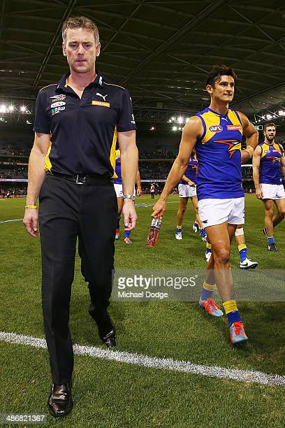 Eagles coach Adam Simpson and Sharrod Wellingham walk off after their defeat during the round six AFL match between the Carlton Blues and the West...