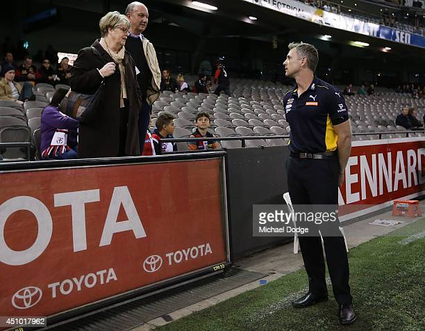 Eagles coach Adam Simpson talks to fans during the round 14 AFL match between the St Kilda Saints and the West Coast Eagles at Etihad Stadium on June...