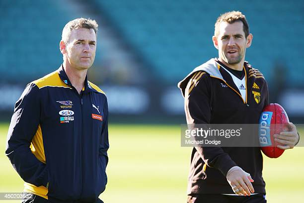 Eagles coach Adam Simpson talks with Hawks Captain Luke Hodge during the round 12 AFL match between the Hawthorn Hawks and the West Coast Eagles at...