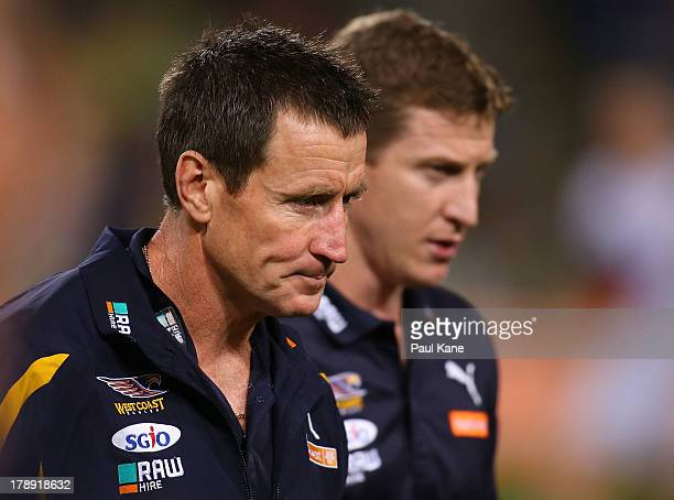 Eagles coach John Worsfold and his assistant Scott Burns walk from the field after the three quarter time break during the round 23 AFL match between...