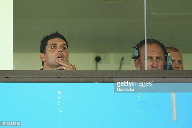 Eagles coach Trent Barrett and assistant coach John Cartwright watch on from the coaches box during the NRL Trial match between the Cronulla Sharks...