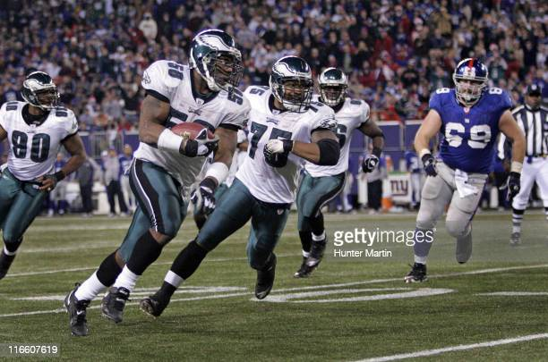 Eagles defensive end Trent Cole runs back an interception for a touchdown during the game between the Philadelphia Eagles and the New York Giants at...