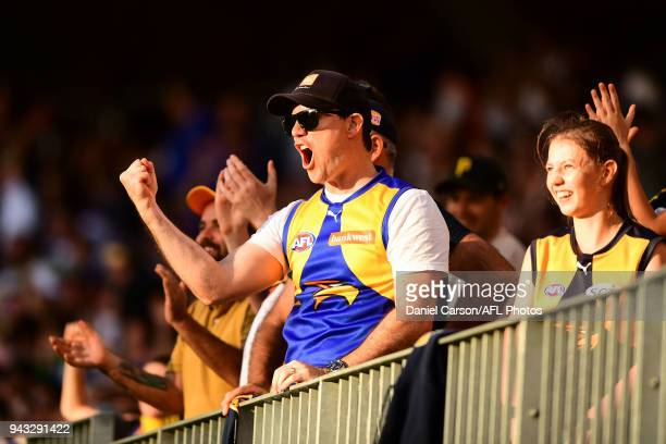 Eagles fans celebrate a goal during the 2018 AFL round 03 match between the West Coast Eagles and the Geelong Cats at Perth Stadium on April 8 2018...
