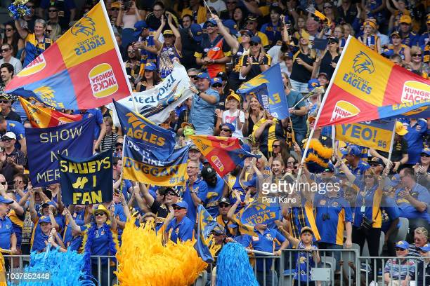Eagles fans celebrate a goal during the AFL Preliminary Final match between the West Coast Eagles and the Melbourne Demons on September 22 2018 in...