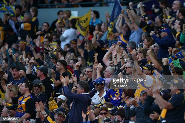 Eagles fans celebrate a goal during the round 23 AFL match between the West Coast Eagles and the Adelaide Crows at Domain Stadium on August 27 2017...