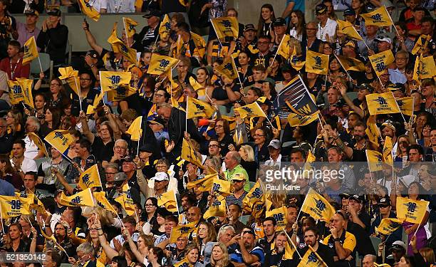 Eagles fans celebrate a goal during the round four AFL match between the West Coast Eagles and the Richmond Tigers at Domain Stadium on April 15 2016...