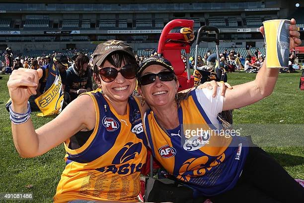 Eagles fans celebrate a goal while watching the 2015 AFL Grand Final between the West Coast Eagles and the Hawthorn Hawks on the big screen at Domain...