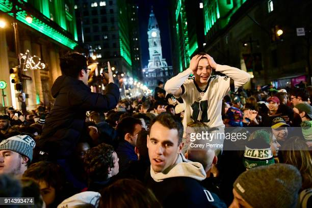 Eagles fans react to Super Bowl LII on Walnut and Broad Streets near City Hall on February 4 2018 in downtown Philadelphia Pennsylvania The...