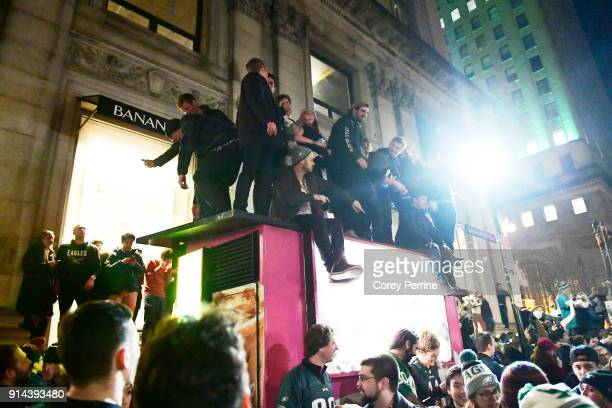 Eagles fans react to Super Bowl LII on Walnut Street near City Hall on February 4 2018 in downtown Philadelphia Pennsylvania The Philadelphia Eagles...