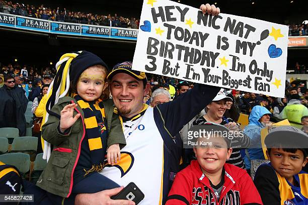 Eagles fans show their support during the round 16 AFL match between the West Coast Eagles and the North Melbourne Kangaroos at Domain Stadium on...