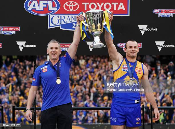 Eagles head coach Adam Simpson and Shannon Hurn of the Eagles hold up the premiership cup after their win during the 2018 AFL Grand Final match...