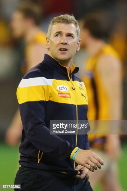 Eagles head coach Adam Simpson looks at the scoreboard at at three quarter time during the round five AFL match between the Hawthorn Hawks and the...