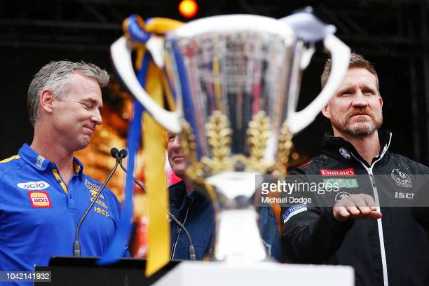 Eagles head coach Adam Simpson reacts as Magpies head coach Nathan Buckley asks Magpies fans to calm during the 2018 AFL Grand Final Parade on...