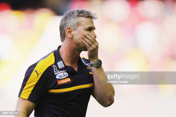 Eagles head coach Adam Simpson walks off at at three quarter time during the round nine AFL match between the Essendon Bombers and the West Coast...