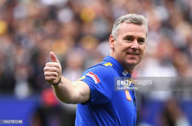 Eagles head coach Adam Simpson waves to the crowd during the 2018 AFL Grand Final match between the Collingwood Magpies and the West Coast Eagles at...