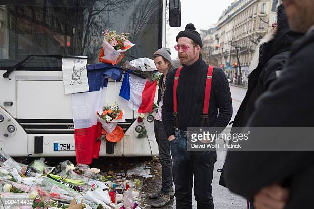 Eagles of Death Metal frontman Jesse Hughes and drummer Julian Dorio visit a memorial that pays homage to the victims of the terrorist attacks at Le...