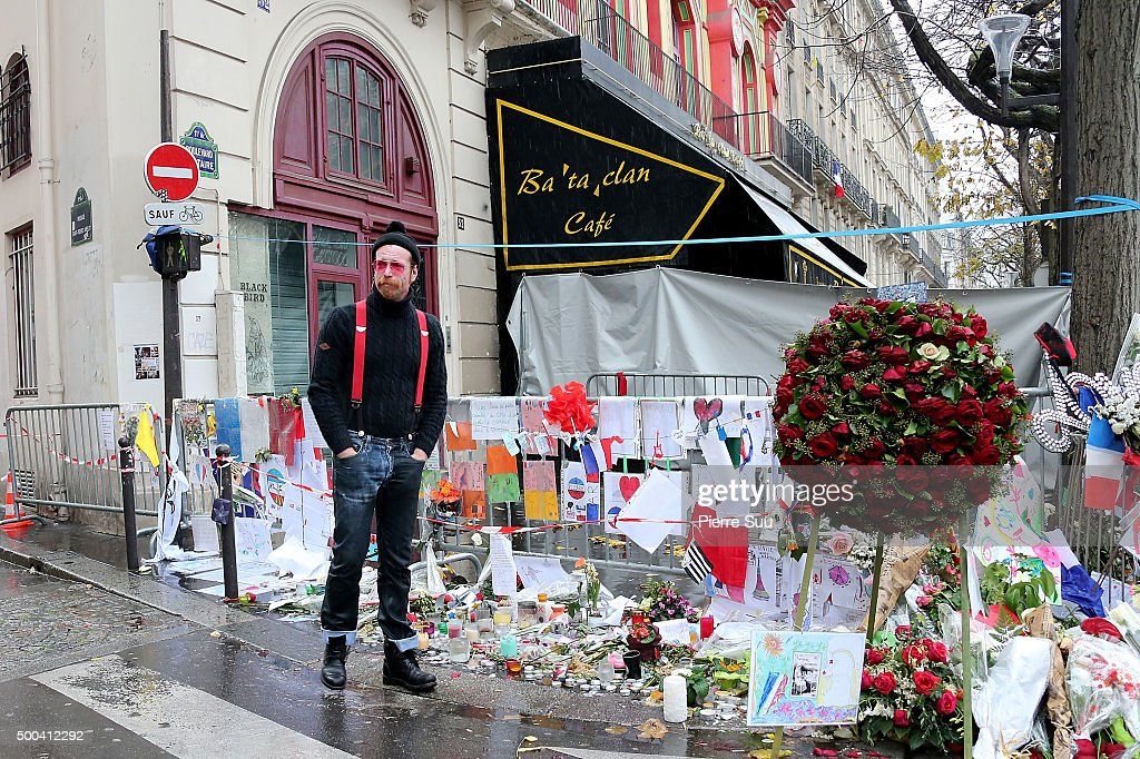 Eagles of Death Metal frontman Jesse Hughes shows his emotions as he looks at the flower memorial in front of The Bataclan concert hall on December 8, 2015 in Paris, France. The Eagles of Death Metal band returned to the Bataclan concert hall for the first time since the deadly terrorist attacks on November 13th where 130 people lost their lives and many more were injured.