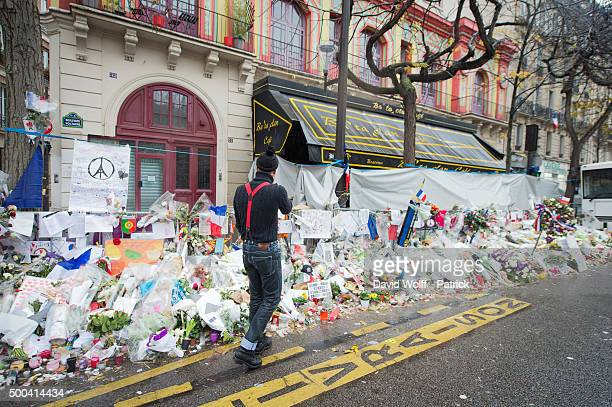 Eagles of Death Metal frontman Jesse Hughes visits a memorial that pays homage to the victims of the terrorist attacks at Le Bataclan on December 8...