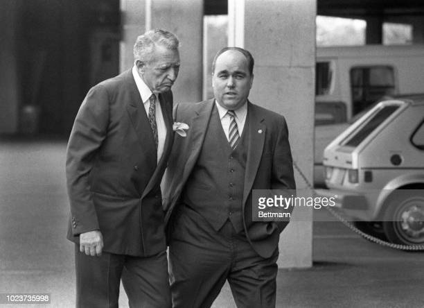 Eagles owner, Leonard Tose speaks with his general manager, Jim Murray, on his arrival at Vet Stadium to meet with his coaches as the fist day of the...