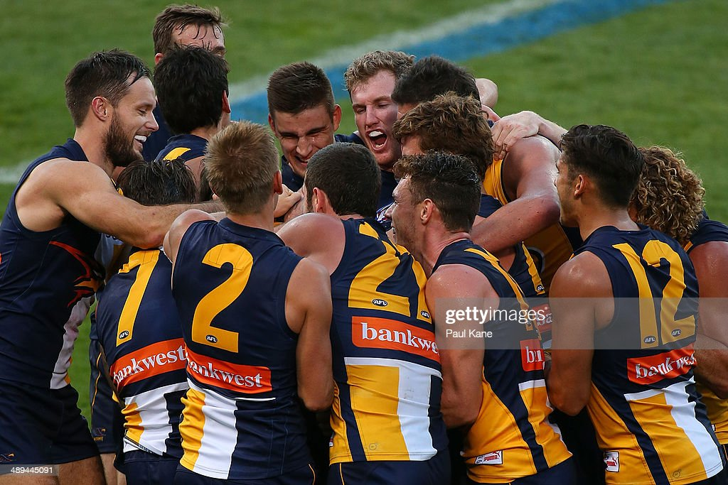 Eagles players celebrate with Josh Kennedy after kicking his tenth goal during the round eight AFL match between the West Coast Eagles and the Greater Western Sydney Giants at Patersons Stadium on May 11, 2014 in Perth, Australia.